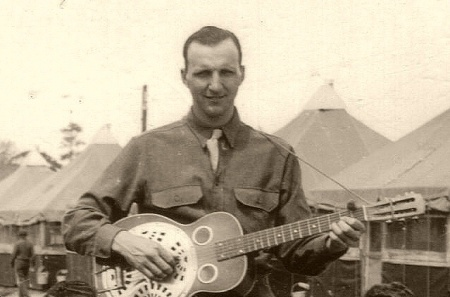 lt-maurice-shock-playing-his-guitar-about-1944-45